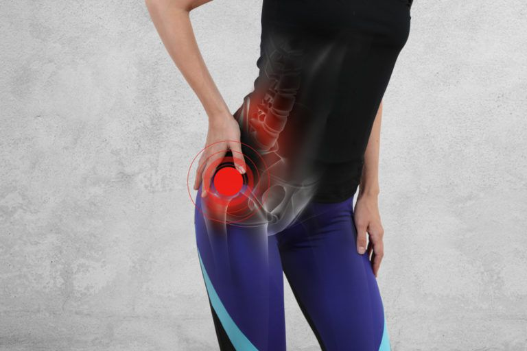 Woman with hip joint pain. Sport exercising injury