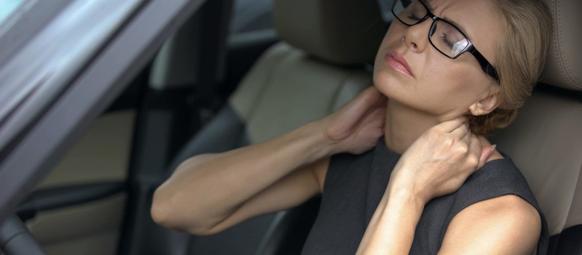 Tired business lady in car feeling strong neck pain
